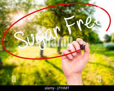 Man Hand writing Sugar Free with black marker on visual screen. Isolated on nature. Business, technology, internet - Stock Photo