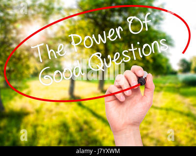 Man Hand writing The Power Of Good Questions with black marker on visual screen. Isolated on nature. Business, technology, - Stock Photo