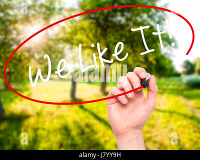 Man Hand writing We Like It! with black marker on visual screen. Isolated on background. Business, technology, internet - Stock Photo