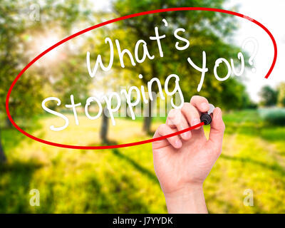 Man Hand writing What's Stopping You?  with black marker on visual screen. Isolated on nature. Business, technology, - Stock Photo