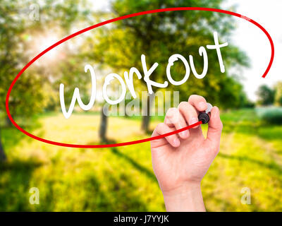 Man Hand writing Workout   with black marker on visual screen. Isolated on nature. Business, technology, internet - Stock Photo