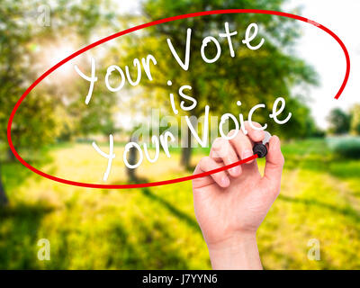 Man Hand writing Your Vote is Your Voice with black marker on visual screen. Isolated on nature. Business, technology, - Stock Photo