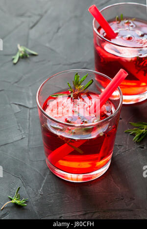 Summer refreshing cocktails with strawberry and thyme on a concrete background - Stock Photo