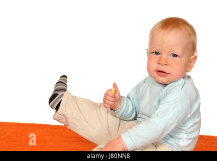 baby childhood young younger eating eat eats toddler isolated optional scrabble - Stock Photo
