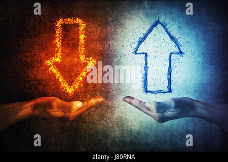 Two human hands holding flaming and splashing infographic arrows on a gray background. Business situation, growth - Stock Photo