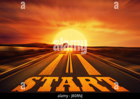 Word Start written on an asphalt road and two arrows as motivation. Long way ahead as a concept of start straight - Stock Photo