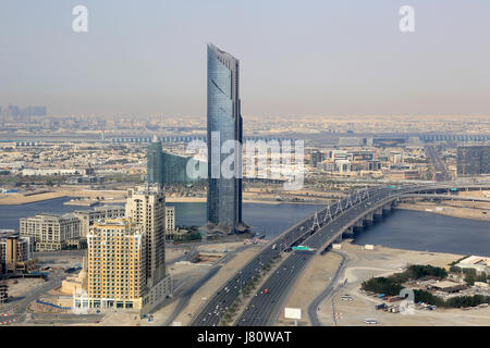 Dubai D1 Tower Business Bay Bridge aerial view photography UAE - Stock Photo