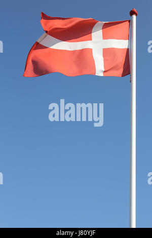 Danish flag flying in the wind - Stock Photo
