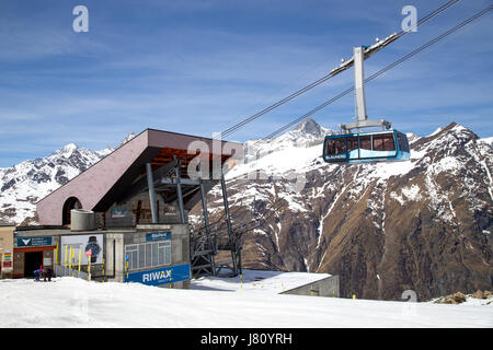 Zermatt, Switzerland - April 12, 2017: The Blauhorn-Rothorn cable car approaching the Blauhorn station - Stock Photo