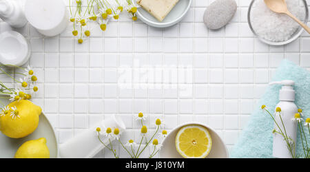 Spa still life with candles,oil,soap,salt,lemon and chamomile - Stock Photo
