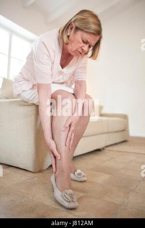 Woman with leg pain. - Stock Photo