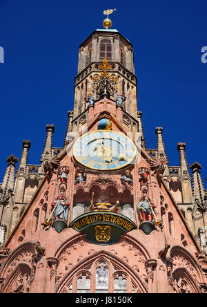 Germany, Bavaria, Nuremberg, Marktplatz, Facade of the 14th century Frauenkirche or Church of Our Lady, also visible - Stock Photo