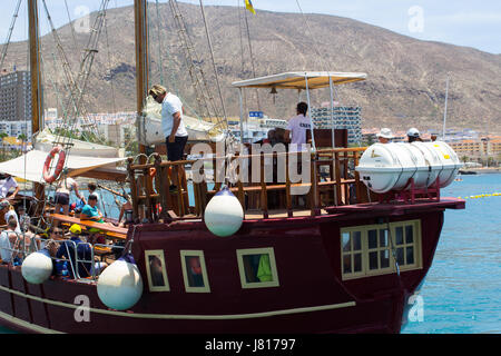 The retro galleon Peter Pan used for tourists fun tours in Teneriffe leaves the quayside at Los Cristianos with - Stock Photo