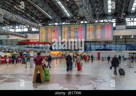 Prague, Czech Republic - March 21, 2017: People waiting in front of the flight information panel at Prague International - Stock Photo