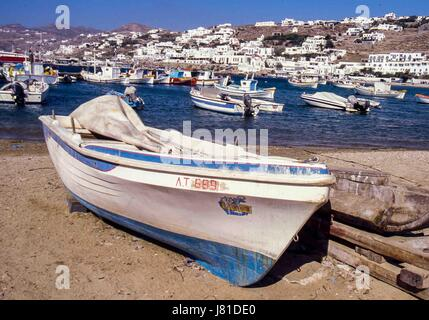 Chora, Mykonos, Greece. 3rd Oct, 2004. Beached boats in the busy, picturesque old harbor of Chora. Mykonos attracts - Stock Photo