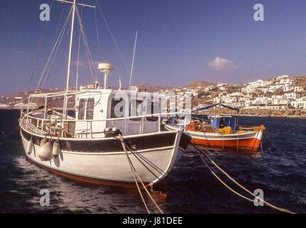 Chora, Mykonos, Greece. 3rd Oct, 2004. Boats in the busy, picturesque old harbor of Chora. Mykonos attracts many - Stock Photo