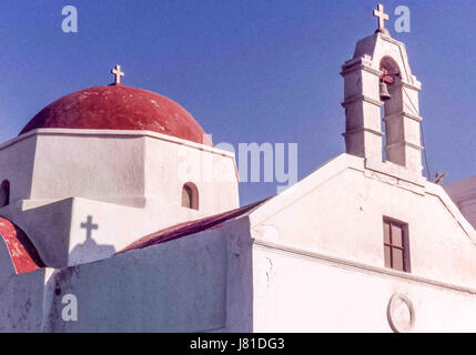 Chora, Mykonos, Greece. 3rd Oct, 2004. A traditional red-domed Greek Orthodox church in the town of Chora on the - Stock Photo