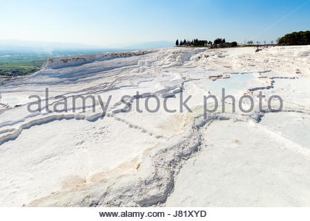 Natural travertine pools and terraces at Pamukkale ,Turkey. Pamukkale, meaning 'cotton castle' in Turkish. - Stock Photo