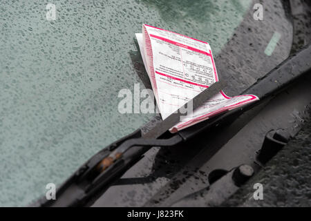Montreal, CA - 25 May 2017: A parking ticket on a car on Laurier Street - Stock Photo