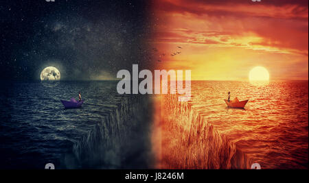 Conceptual view of two worlds collide, as a lost man, in a paper boat, sailing in the middle of the ocean try to - Stock Photo