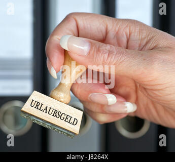 holiday pay - stempel mit hand - Stock Photo