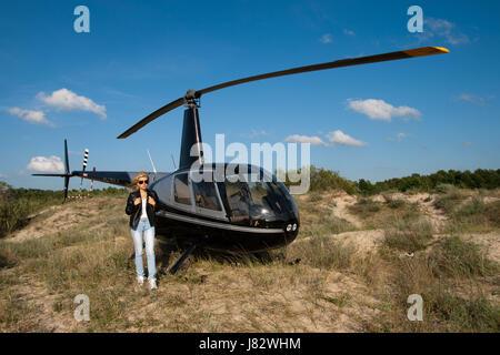woman blue glass chalice tumbler flight traffic transportation beach seaside - Stock Photo