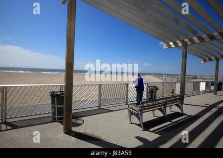 person enjoying the ocean view at Rockaway Beach New York