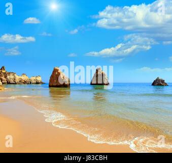Sandy beach Dos Tres Irmaos summer  sunshiny view with blue cloudy sky (Portimao, Alvor, Algarve, Portugal). - Stock Photo