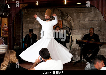 Istanbul, Turkey - May 7, 2017: The dance Whirling Dervishes is called Sema while peoples watch him - Stock Photo