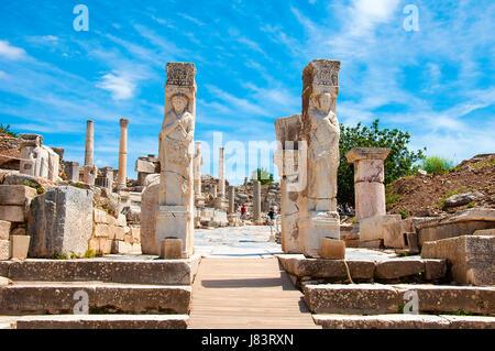 Ephesus. Aydin, Turkey - May 10, 2017: Tourists walking around of  Hercules Gate in   Ephesus , Kusadasi Turkey - Stock Photo