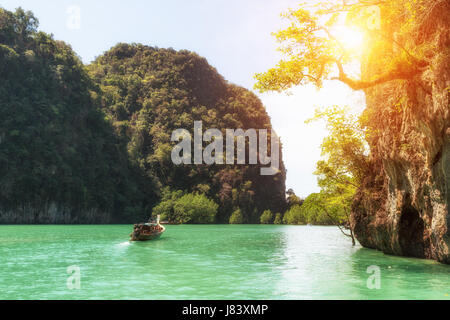 Beautiful landscape of rocks mountain and crystal clear sea with longtail boat at Phuket, Thailand. Summer, Travel, - Stock Photo
