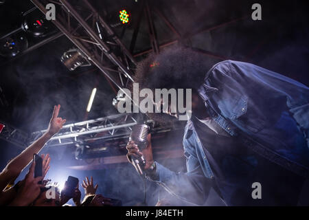Singer performing on stage in nightclub - Stock Photo