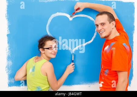 colour romantic wall paint draw message love in love fell in love couple pair - Stock Photo