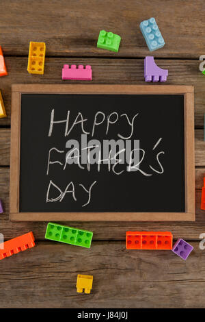 Close-up of happy fathers day message written on slate - Stock Photo