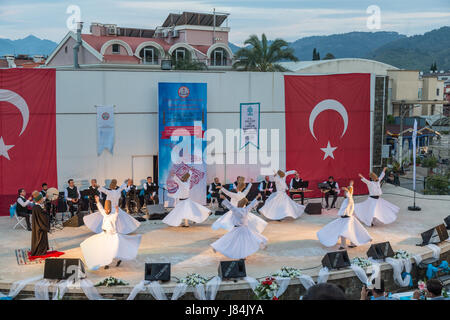 At Marmaris amphitheater in Marmaris, Mugla, Turkey - May 26, 2017 : Whirling dervishes show and religious music - Stock Photo