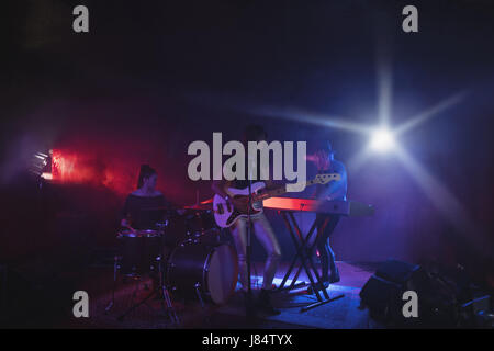 Group of females performing on stage in nightclub - Stock Photo