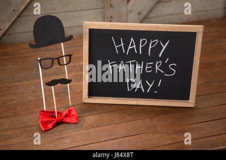 Close-up of happy fathers day message on slate - Stock Photo