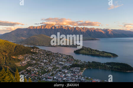 View of Lake Wakatipu and Queenstown at sunset, Ben Lomond Scenic Reserve, Mountain Range The Remarkables, Otago, - Stock Photo