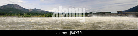 dam embankment lock mountain river water table energy power electricity - Stock Photo