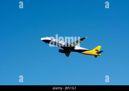 Monarch Airlines Airbus A321 taking off at Birmingham Airport, UK (G-OZBH) - Stock Photo