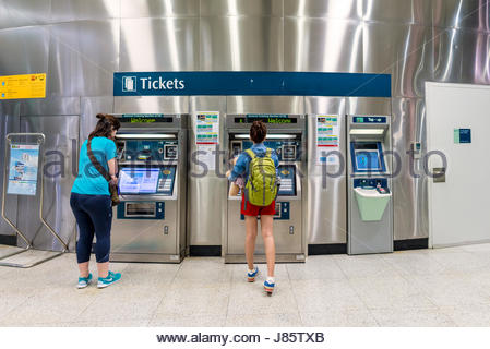 SINGAPORE - JULY 10: Unidentified people buy tickets at The Mass Rapid Transit (MRT) on July 10, 2015 in Singapore. - Stock Photo