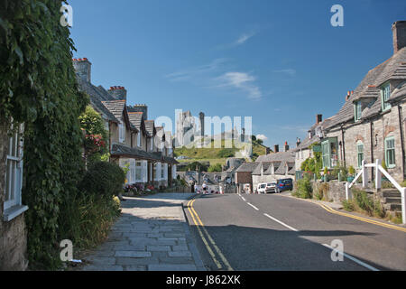 The castle, from East Street, Corfe Castle, Isle of Purbeck, Dorset - Stock Photo