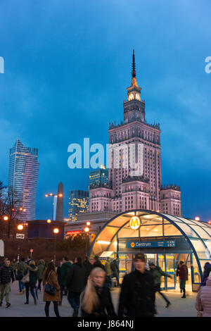 Warsaw's Centrum with the Palace of Science and Culture beyond as well as a modern high rise building. - Stock Photo