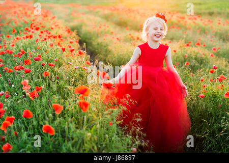 kid fashion, wedding, summer, weekends, flora, freedom concept - sorrounded by poppies little adorable model with - Stock Photo