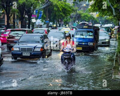 Bangkok, Bangkok, Thailand. 27th May, 2017. A motorcyle taxi on Ekkamai Road, flooded by monsoonal rains, in suburban - Stock Photo