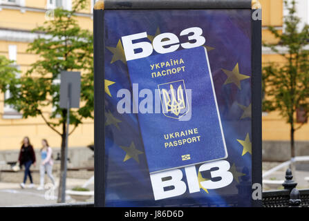 May 27, 2017 - Kiev, Ukraine - A banner with image of Ukrainian passport on the background of the European Union - Stock Photo