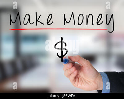 Businessman hand writing make money on virtual screens. Dollar symbol. Isolated on office. Business, technology, - Stock Photo