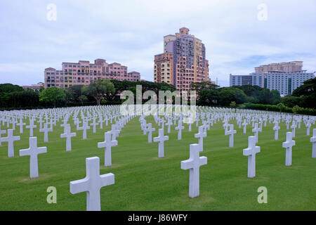 Headstones made of marble at the Manila American Cemetery and Memorial which has the largest number of graves of - Stock Photo