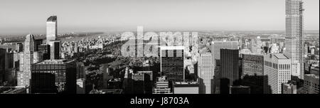 Black & White aerial panoramic view of Central Park with Midtown skyscrapers, Upper West and Upper East Side buildings. - Stock Photo