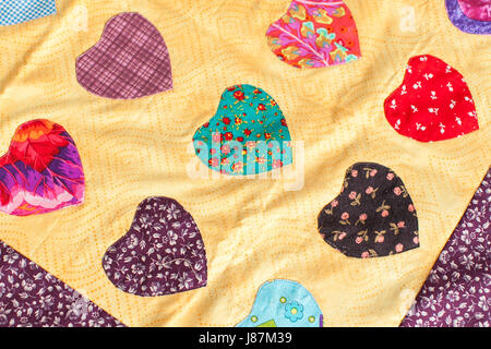 Patchwork quilt. Part of patchwork quilt as background. Handmade - Stock Photo